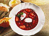 Cold soup with berries and cinnamon cream dumplings
