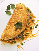 Omelette filled with peas, carrots & cress sprouts