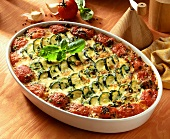 Courgette and tomato casserole in a casserole dish