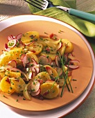 Potato salad with radishes, onions and chives