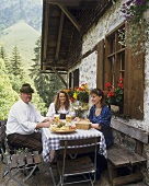 Lunch outside Engeratsgrund alpine hut: 2 girls & innkeeper