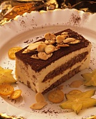 A Piece of Tiramisu with Nuts and Tropical Fruit