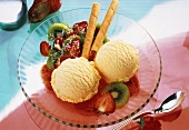 2 scoops of ice cream, strawberry & kiwi salad, wafer roll