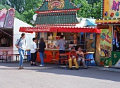 Stall with Asian Specialties at the May Fair in Regensburg