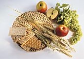 Various crispbreads, ears of corn, apples & grapes