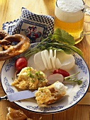 Bavarian snack: radish, cheese spread, pretzel & light beer