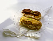 Two eclairs with cream and maraschino filling