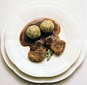 Pork fillets with caraway in beer sauce & bread dumplings