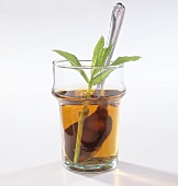 A glass of peppermint tea with fresh mint