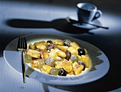 Browned Pancake (Kaiserschmarren) with Grapes and Powdered Sugar