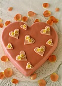 Heart-shaped punch cake with pink icing
