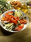 Antipasto platter with vegetables, olives, sardines, ham