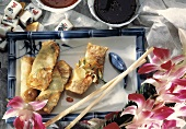 Spring Rolls on a Tray; Orchids