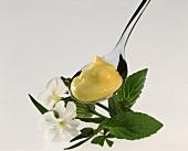 Mustard mayonnaise on spoon, decoration: flowers