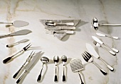 Assorted Flatware and Cutlery on Marble