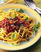 Spaghetti with tomato & caper sauce, chili rings & basil