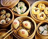 Various Asian pasties & dumplings in steaming baskets