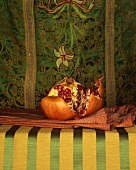 Pomegranate Broken Open; Resting on a Cloth