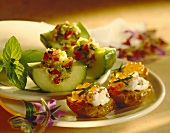 Potatoes with caviare and filled cucumber boats
