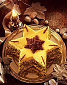 Star-shaped cake with icing, chocolate sprinkles & pistachios