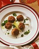 Kofta balls in garlic yoghurt sauce with cucumber and mint