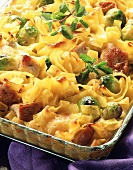 Ribbon pasta bake with diced pork and Brussels sprouts