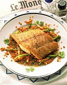 Nile perch on red lentils