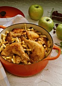 Spicy apple chicken with raisins & Calvados in stewpot