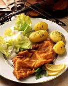 Wiener Schnitzel with lettuce and boiled potatoes
