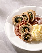 Chicken breast roulades stuffed with spinach,pomegranate sauce