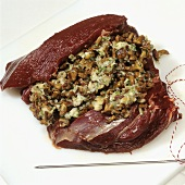 Preparing leg of venison 'Forester's style' (stuffing the meat)