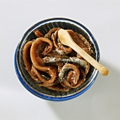 Anchovies in a Bowl; Wooden Spoon