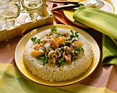 Rice border with mixed vegetable and mushroom ragout