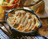 Swiss cheese souffle in souffle dish