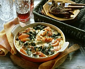 Spinach and tomato gratin with ham strips & lamb cutlets