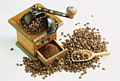 Old coffee mill with ground coffee and coffee beans