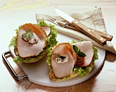 Bread rolls topped with lettuce & slices of turkey breast