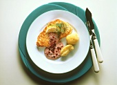 Shark steak with cranberry sauce and boiled potatoes