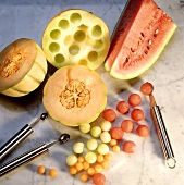 Cutting out melon balls with various melon ballers