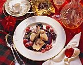 Iced gugelhupf on mixed berry sauce
