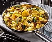 Vegetarian curried rice with vegetables, peanuts & tofu