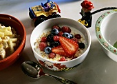Oat muesli with fresh berries for children's' breakfast
