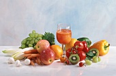 A glass of multi-vitamin juice and fresh fruit & vegetables