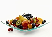 Fruit and berries in a glass bowl