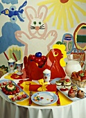 Children's Easter table with savoury snacks and cocoa
