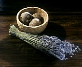 A bunch of dried lavender sprigs & dried mangosteens