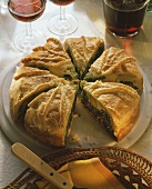 Puff pastry pie with spinach & ricotta filling and egg