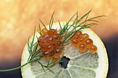 Keta caviare (salmon caviare) with dill on slice of lemon