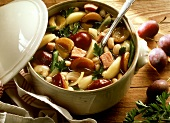 Bean stew with plums, smoked pork rib and potatoes