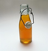 Diluted concentrated apple juice in a glass bottle